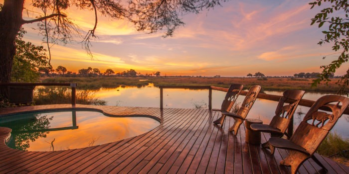 kwando lagoon camp pool sunset