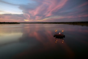 zambia livingstone tongabezi floating dinner romatic setting sunset