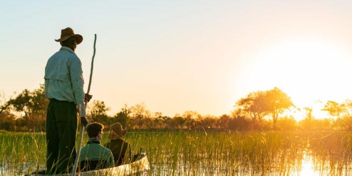 okavango delta mokoro guests sunset