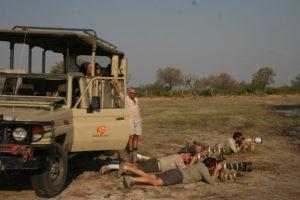 botswana photographic safari lyinf on floor