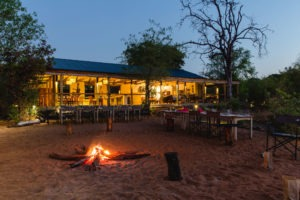chobe elephant camp fireplace at night