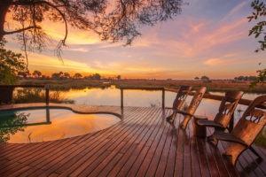 kwando lagoon camp pool sunset