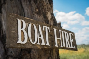 moremi boat hire sign