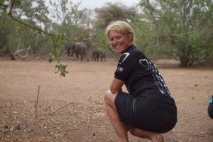 northern tuli botswana cycling safari sitting with elephants
