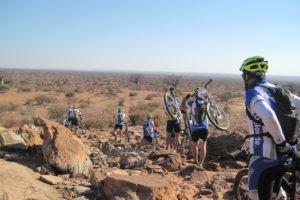 northern tuli botswana cycling safari team on hill