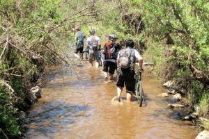 northern tuli botswana cycling safari walking through water