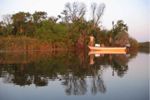 okavango delta botswana fishing boat along river