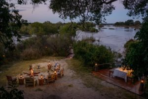zambia livingstone sindabezi dinner setting on river